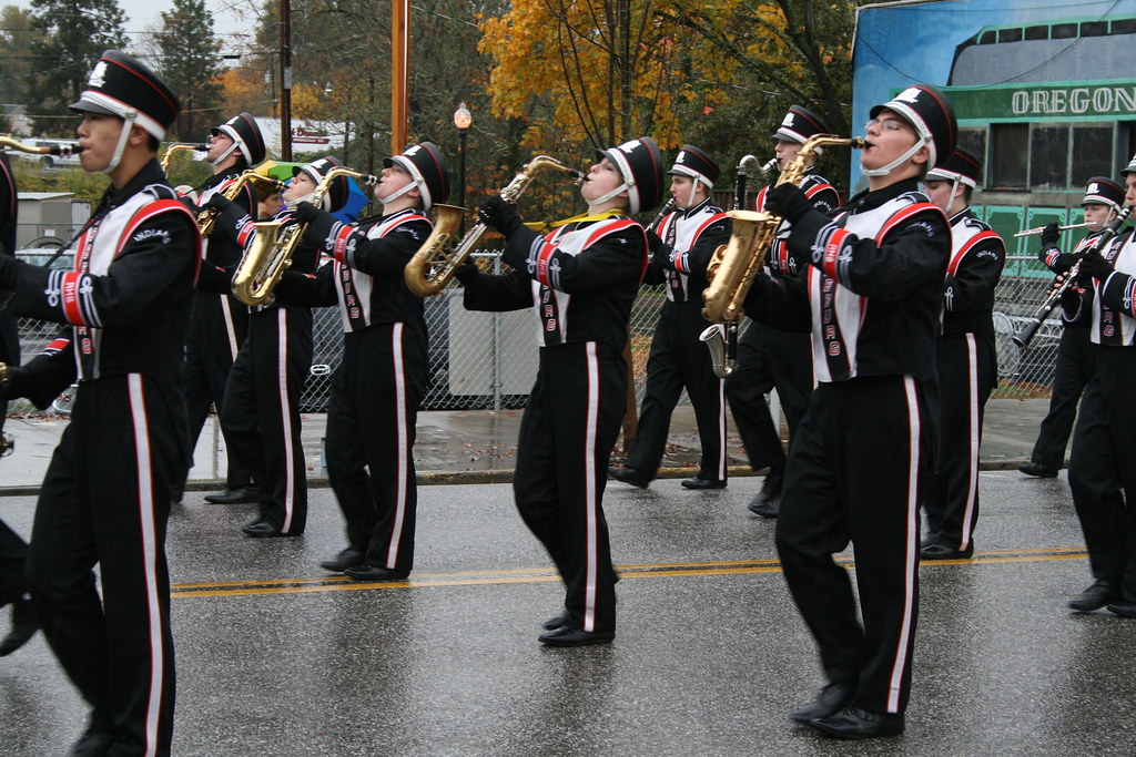The alto saxophone section marching