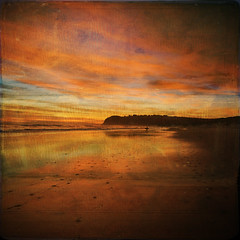 Being... (borealnz) Tags: sunset sea newzealand sky beach clouds reflections square sand surfer nz otago dunedin stkilda bsquare memoriesbook borealnz