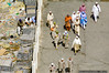 Workers | Walkers (Shabbir Siraj) Tags: life city travel people wall walking nikon afternoon muslim islam working middleeast saudi arabia nikkor 2008 saudiarabia pilgrimage pilgrims ksa d40 nov08 munawwara