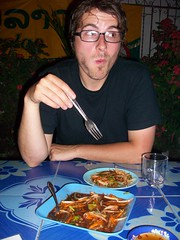 eating the spiciest thing in the world (danenestos) Tags: food asian cuisine spicy laos sweating