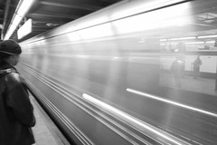 The Speeding Bullet (RMac_Photography) Tags: nyc longexposure nightphotography people blackandwhite bw newyork motion blur d50 geotagged nikon streetphotography cityscapes rmac supershots nightshpts