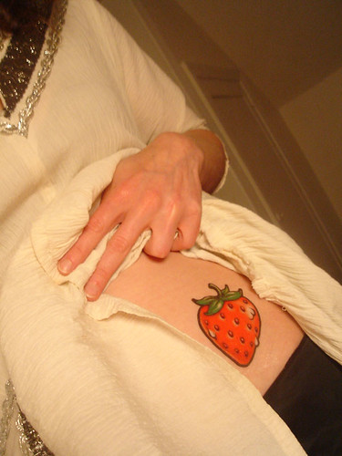 Tattoo the word awesome under the strawberry. Strawberry Tattoo
