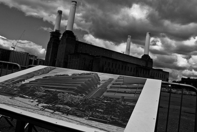 Battersea Power Station with a picture of the proposed redevelopment in the foreground