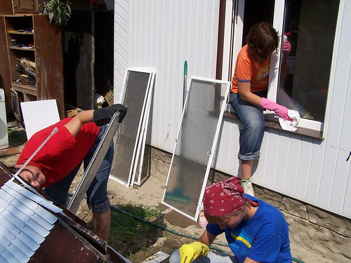 Mira, Vlada, and Olya cleaning windows and screens