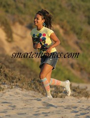 christina milian on the set of her new movie .....running like a certain rapper when the ogs tried take his chain