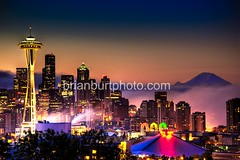 Foggy Sunrise, Seattle Skyline & Mt. Rainier (briburt) Tags: seattle city longexposure nightphotography morning sky urban mist mountain color colors fog skyline architecture night clouds sunrise buildings d50 landscape dawn lights volcano photo washington twilight lowlight nikon colorful cityscape nightscape skyscrapers image availablelight earlymorning picture bluesky nikond50 citylights mountrainier rainier cascades pacificnorthwest spaceneedle existinglight kerrypark bluehour transition mtrainier iconic keyarena bigcity dreamscape urbanlandscape cascademountains bigcitylights lowlightphotography cooliris northofnormal briburt