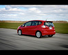 Honda Fit [rear]. (< brian >) Tags: auto red car speed magazine track rear hondafit comparo subcompacts cartocar cayugaspeedway