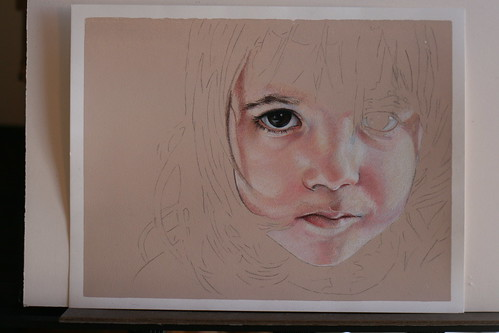 Photo of in progress and as yet untitled colored pencil portrait of my daughter.