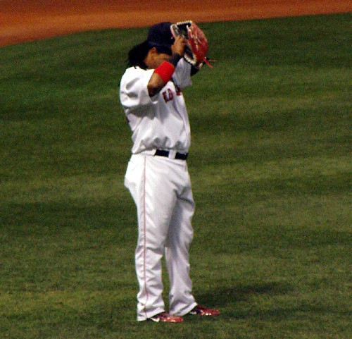 Manny adjusting his hat...