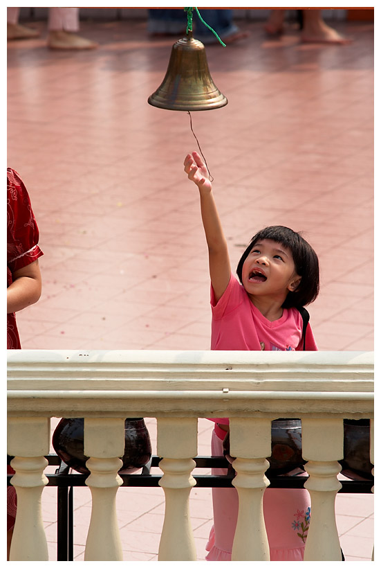 Little Girl Reaching for the Bell