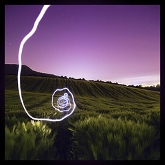 and suddenly.. it disappears! (Paul Petruck) Tags: longexposure sky nature night landscape fun corn purple dream experiment surreal swirl 1000views 500x500 lightgames youvsthebest seenintheinterestingnessarchives winner500 vision100 thepinnaclehof