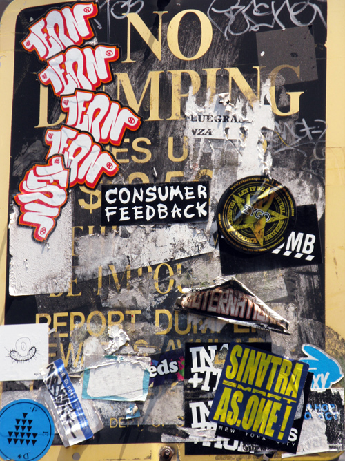 stickers and graffiti on a No Dumping sign, Manhattan, NYC
