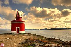 Cabo Home (Roberto Alarcon) Tags: blue sunset sea lighthouse color sol water azul clouds faro mar cabo nikon playa galicia nubes vistas puesta ocaso pontevedra ria vigo acantilado riasbaixas oceano rias atlantico bajas cies cangas baixas 18135 d80 ltytr2 ltytr1 nikonflickraward