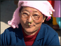 A colorful and happy buyer of veggies (Sukanto Debnath) Tags: pink portrait woman india lady nose glasses market sony ring f828 sikkim nepali sikkimese debnath sukanto sukantodebnath kaluk