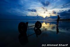 Sunset at Kuakata Beach....... [Kuakata, Patuakhali, Bangladesh] (Ideas_R_Bulletproof) Tags: sunset sea sun color colour reflections d50 boat fishing fisherman nikon horizon wheels staring bangladesh concern kuakata sigma1020mmf456exdchsm patuakhali bayiofbengal