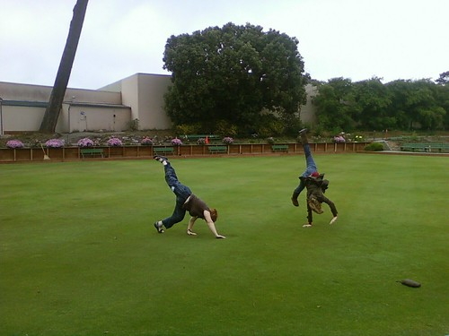Lorelle and a friend do cartwheels in Golden Gate Park for the WordPress Scavenger Hunt