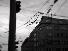 Wired city...... (Radek Bednak) Tags: city urban panorama blur detail building public wall town wire moody sad decay panoramic wires transportation atmospheric negativ hopeful depressive