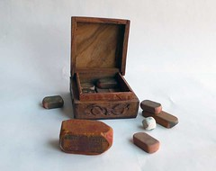 Box of used erasers (Manitoba Museum of Finds Art) Tags: pinkpearl woodenbox permanentcollection manitobamuseumoffindsart olderasers usederasers
