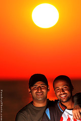 sun friends (A.alFoudry) Tags: ocean camera morning friends light sea orange sun black beach speed sunrise canon lite eos dawn gulf friendship flash off chalet kuwait usm rise 2008 ef bader kuwaiti transmitter q8 30d saleh abdullah 400mm  speedlite   kuw ste2 canoneos30d gulfsea q80 f56l strobistcom strobist xnuzha alfoudry canonef400mmf56lusm shaleh  abdullahalfoudry  foudryphotocom alajeel baderalajeel algaith salehalgaith