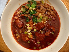 Pork stew with greens and beans