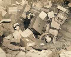 U.S. Troops Surrounded by Holiday Mail During WWII (Smithsonian Institution) Tags: christmas family blackandwhite food brown holiday men love sepia work chaos post mail buried box military wwii working