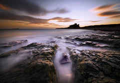 Bamburgh Beach; Northumberland (Corica) Tags: uk longexposure greatbritain england seascape castle beach sunrise rocks britain northumberland bamburgh lanscape basalt bamburghcastle dolerite corica greatwhinsill