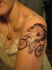 a fish needs a bicycle (Rippingoffthestars) Tags: auto portrait fish selfportrait me bike tattoo self canon autoportrait provincetown capecod powershot outline ptown canonpowershot linework digitalelph sd1100is canonpowershotsd1100isdigitalelph
