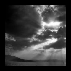the lone fisher (uteart) Tags: sunset man mexico fishing fisherman explore fisher frontpage stormcloud sunbeams darkcloud ajijic chapala lagodechapala utahagen explorefrontpage orthon utehagen uteart explore021809