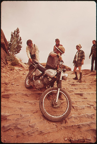 Park Ranger Lends a Hand to Motorcycle Rider Who Can't Manage His Bike on the Steep Road Elephant Hill, Needles Section, 05/1972