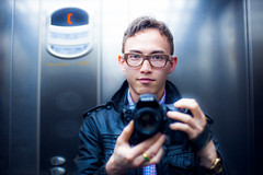 Self Portrait (TGKW) Tags: camera boy portrait people man leather metal digital self lights glasses nikon photographer lift display glasgow buttons elevator jacket spectacles ligths 1265