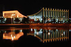 Will to life...إرادة الحياة (radiant guy) Tags: light sea reflection water architecture night words lyrics aqua poem parliament architect kuwait nationalassembly الكويت platinumphoto nationassembly مجلسالأمة
