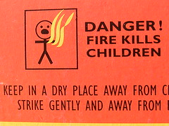 Danger sign (Mr  Tickle - Wachoo Wachoo Tribe Congressman) Tags: red man silly sign yellow danger warning children fire swan funny fuji stickman text flames creative commons finepix match fujifilm stick kills matches matchbox s800 thebiggestgroup s5800 tbgc67