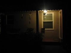 tw 104:  Leave the light on wontcha? (phoebird) Tags: light house night still bricks pillar porch utata form tw basic windchime utata:color=black utata:description=hide phoebird utata:project=nocturnal2 ilovereddoorsandmailboxes utata:project=tw2years