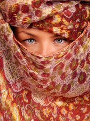 Incognito (Rune T) Tags: red portrait orange scarf eyes colorful pattern dress line hidden incognito