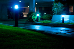 the walk home (Chris Beauchamp) Tags: blue green wet rain night canon lights sigma 30mm xti 400d copyrightchrisbeauchamp20072009