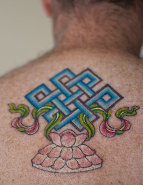 William just got his beautiful endless knot and lotus tattoo finished on