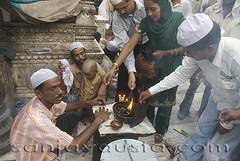 sufi, islamsufi saint, muslims, Lighting incense sticks at Nizamuddin Dargah, New Delhi (sanjayausta) Tags: burn incense indiaasianewdelhistreetphotographysanjayaustacandidpicturesnizamuddinareanizamuddinstreetscenesexoticethnicindianpeopleindians lightincense