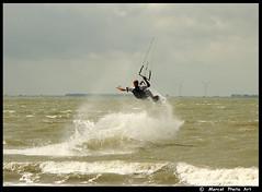 Kite surfer (M-Mick3y) Tags: sea kite man holland beach clouds wind surfer board fast vlissingen kitesurfer industrialarea