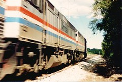 Eastbound Amtrak speeding through Willow Springs Illinois. September 1988.