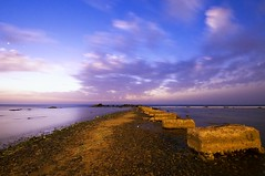 Surrealism (Khaled A.K) Tags: longexposure seascape clouds rocks surreal trail sa jeddah saudiarabia khaled spotmetering waterscape ksa saudia cloudtrail kashkari