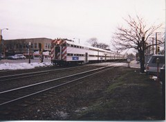 Eastbound Metra / BNSF Railway commuter train. La Grange Illinois. March 1998.