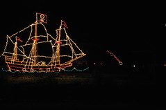 Avast Captain, There's a Ship at Sea, Blast 'em! (dmourati) Tags: california park county christmas lake tree canon geotagged lights nice ship unitedstates flag decoration fantasy pirate attractive los