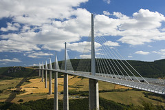 Millau Viaduct (theHungryPigeon) Tags: road bridge summer cloud france field car architecture french landscape concrete wire steel towers pillar cable viaduct pylons a75 span millau cablestayed rivertarn 230countriesfrance