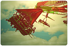 flying fun. (< brian >) Tags: carnival sky people clouds laughing vintage flying ride smiles retro pp havingfun