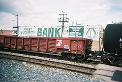 A former Conrail gondola car in tow. Elmwood Park Illinois. May 2008.