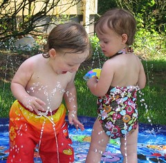 Twins having fun in the water