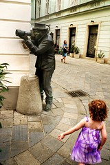 The Petrified Paparazzi (Gilderic Photography) Tags: street city urban sculpture art girl strange statue modern corner lumix weird coin funny europe cityscape photographer robe humour panasonic paparazzi slovensko slovakia rue fille bratislava ville attraction insolite touristic photographe slovaquie instantfave gilderic aplusphoto