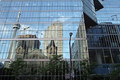 Across the street (guajava) Tags: street trees windows light sky urban toronto ontario canada west reflection tree tower church window glass lamp architecture emily university king day cntower outdoor centre 28mm sigma avenue simcoe foveon sunlife standrew dp1 symphonyplace