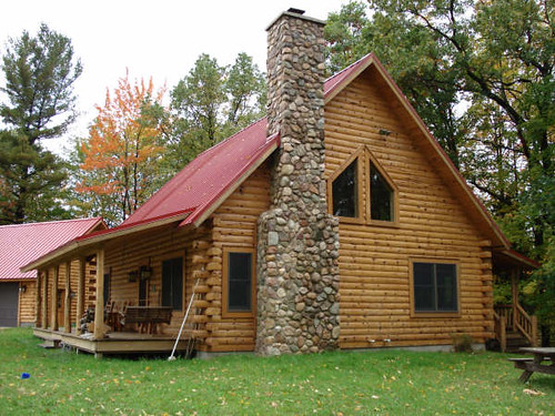 classic log cabin with stone chimney