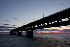 Sunset through the bridge (Damir's) Tags: ocean longexposure bridge light sunset colors night evening 1740l oresundbridge 40d oresundsbron